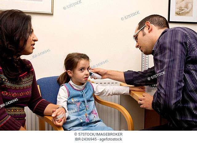 GP doctor's surgery, patient consultation with a girl, United Kingdom, Europe