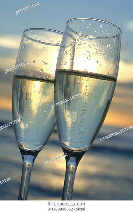 Two glasses of sparkling wine in sunlight