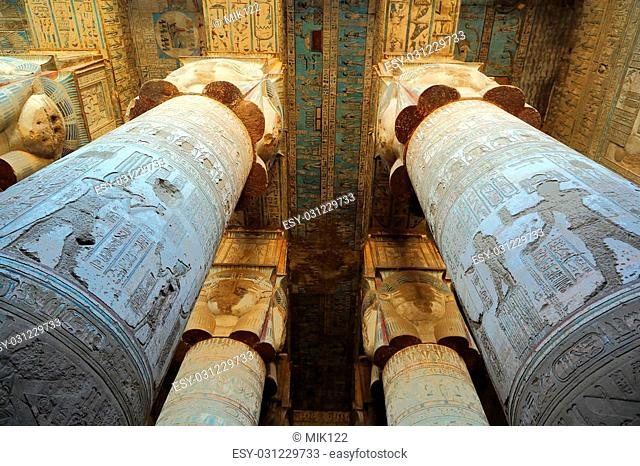 Interior of the painted and carved hypostyle hall at Dendera Temple. Ancient Egyptian temple near Qena