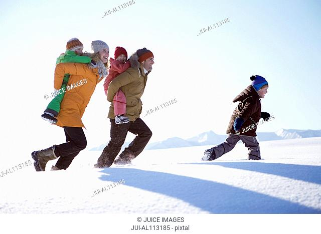 Family walking together through snow
