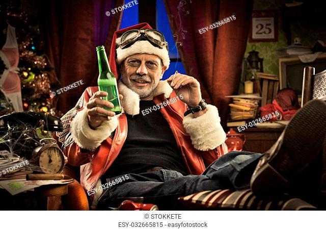Lazy cheerful bad Santa celebrating Christmas at home alone with cigarette and beer