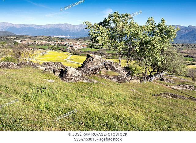 Higuera de las dueñas and the Sierra de Gredos from the Dehesas. Avila. Castilla Leon. Spain. Europe