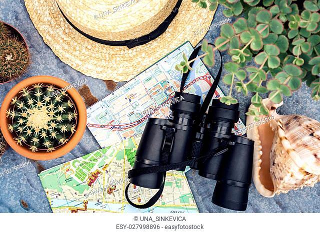 Binoculars, straw hat, map. Traveler set flat lay view, top view