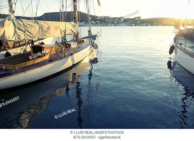 Moored vintage sailboats in the early morning, detail. Port of Mahó, Minorca, Balearic Islands, Spain