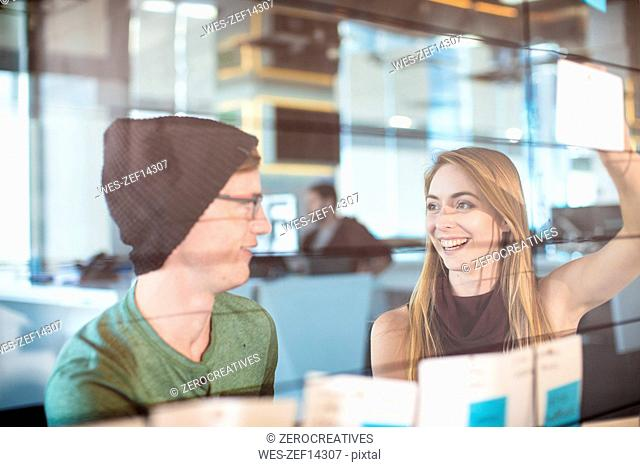 Young man and woman working together in an office
