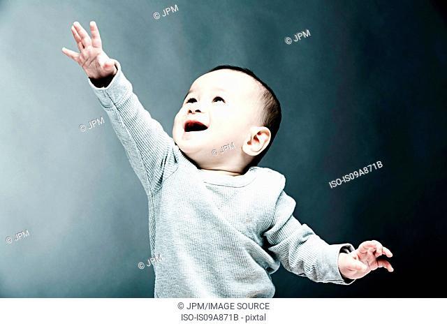 Portrait of baby boy wearing grey top