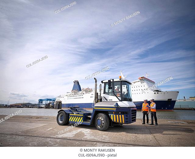 Shipping container truck drivers and ship in port