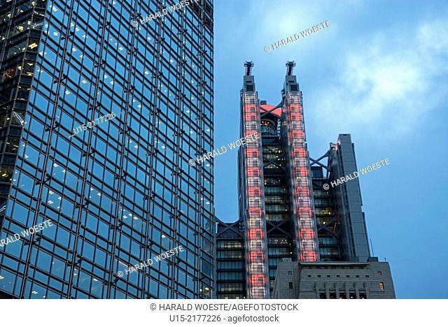 Hong Kong, China, Asia. Hong Kong Central. Towers of the Cheung Kong Center (left), the luminous HSBC bank (middle), and the old Bank of China (bottom right)
