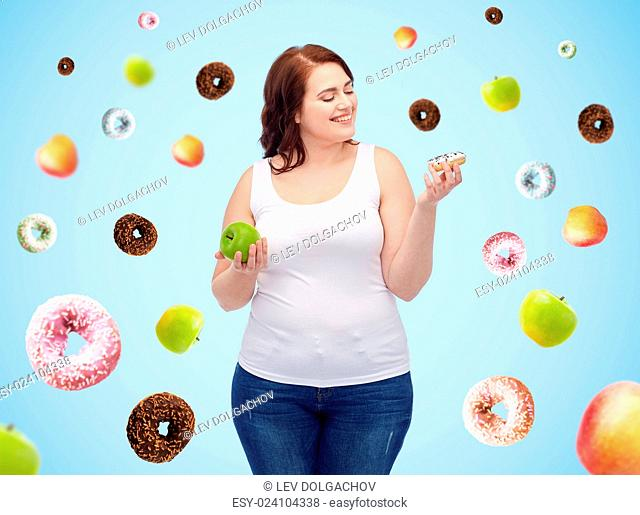 healthy eating, junk food, diet and choice people concept - smiling plus size woman choosing between apple and donut over blue background