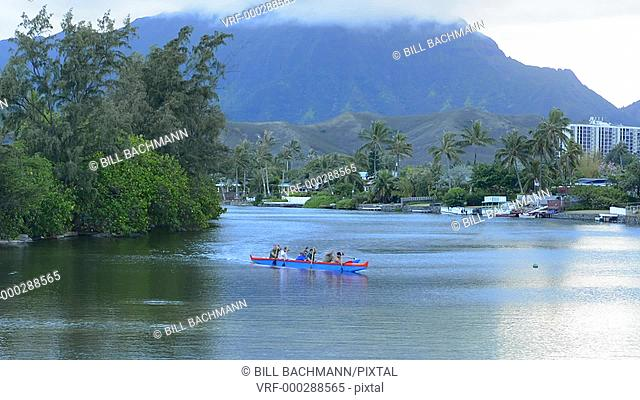 Kailua Hawaii Oahu canoe club rowing on Outrigger Canoes in bay practice sports athletics exercise