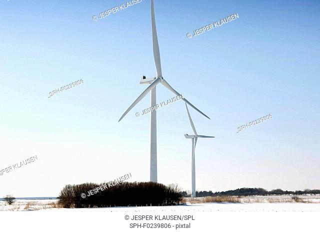 Wind turbines on snow winter landscape