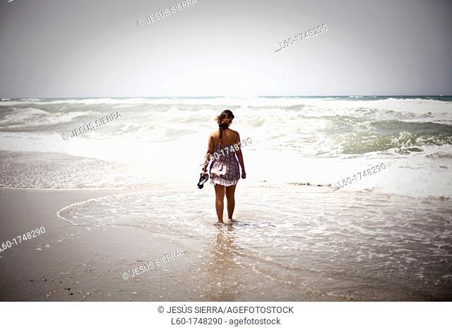 Thinking girl by the sea, Cabo de Gata, Almería, Spain