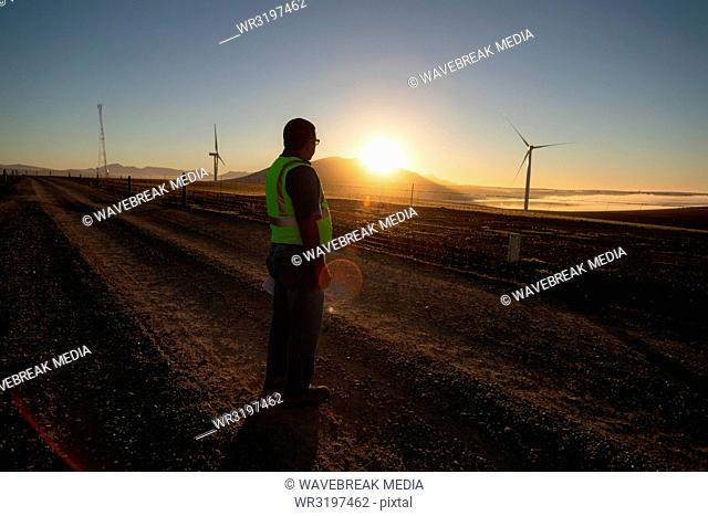 Engineer standing at a wind farm