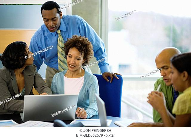 Multi-ethnic business people meeting in office