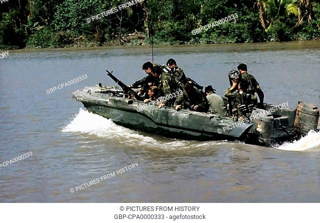 Vietnam: Members of U.S. Navy Seal Team One move down the Bassac River in a Seal team Assault Boat during operations along the river south of Saigon