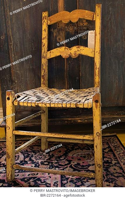 Antique wooden chair and armoire inside an old residential home and antique store, Lanaudiere, Quebec, Canada. This image is property released for calendar