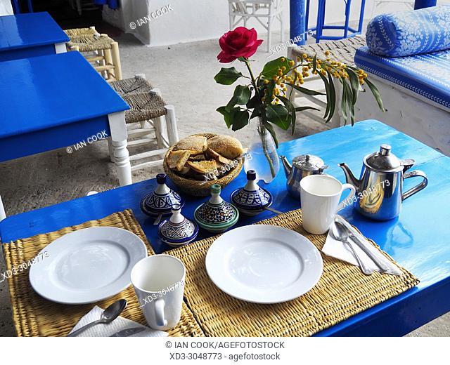 breakfast table in the courtyard of La Kaouki Hotel, Sidi Kaouki, Morocco