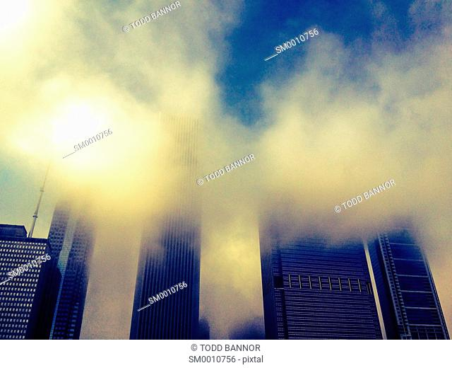 Clouds forming over downtown Chicago skyscrapers. Moisture in northeast wind off Lake Michigan condenses as air rises over skyscrapers