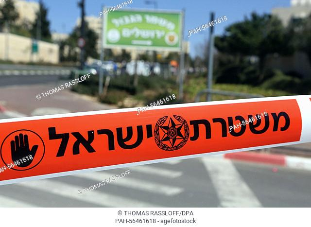 A police line which reads 'Police - Do not cross' cordons off a street corner in Jerusalem, Israel, 6 March 2015. A car driver drove his vehicle into a group of...