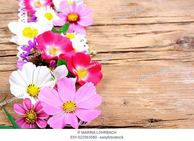 Flowers on wood, space for text