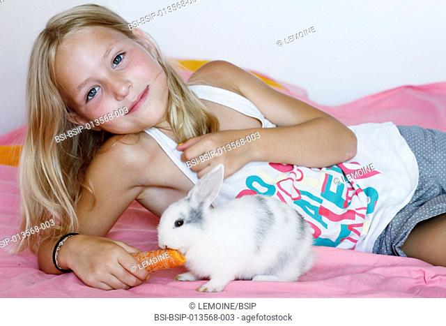 9-year-old girl with her dwarf rabbit