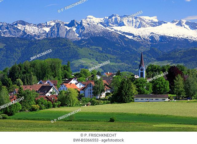 village Bubikon with Glaernisch in the background, Switzerland, Zuercher Oberland