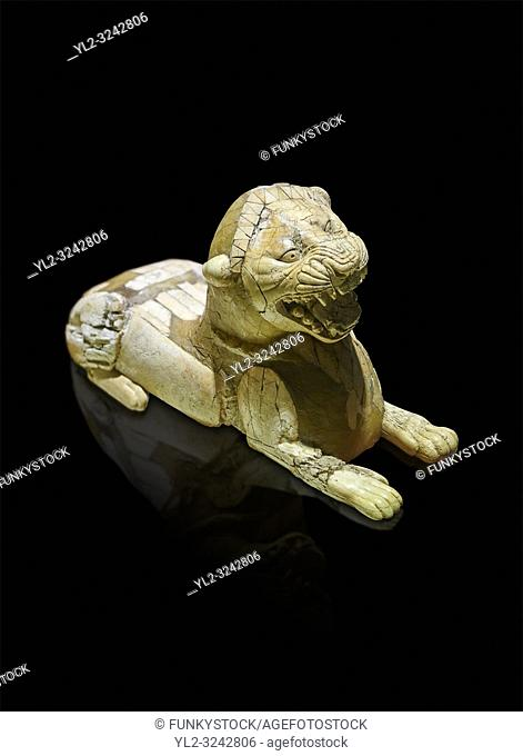 Phrygian ivory statuette carved as a roaring lion lying down from a table base decoration. From Gordion. Phrygian Collection