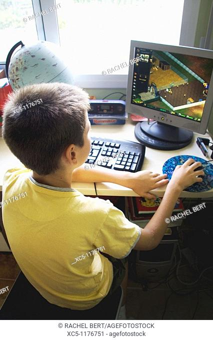 9 years old boy playing at pc