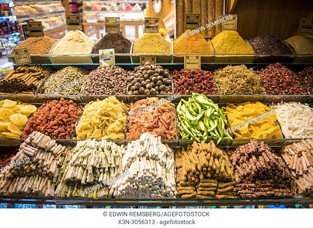 Orderly piles of various dried fruits, spices and other goods