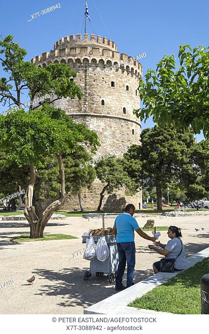 Street vendor selling Koulouri bread rings by The White Tower on Thessaloniki waterfront. Macedonia, Northern Greece