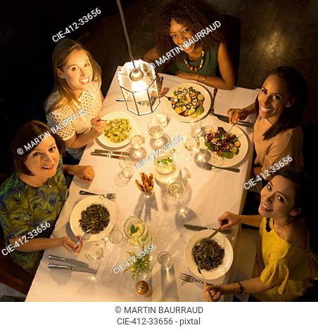 Portrait smiling women friends dining at restaurant table