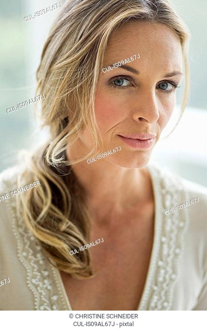 Mature blonde woman looking at camera, portrait