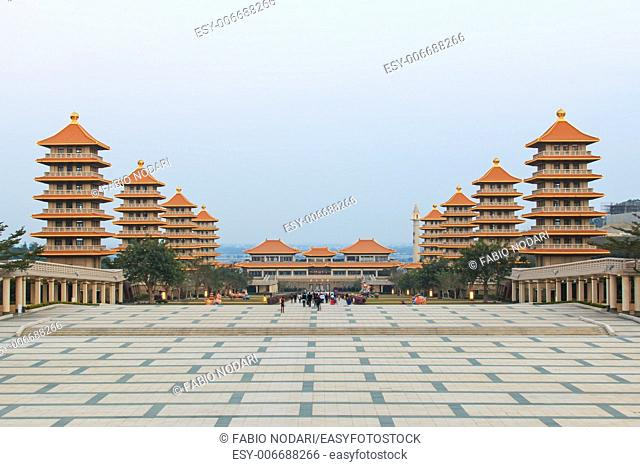 Kaohsiung, Taiwan: Sunset at Fo Guang Shan buddist temple of Kaohsiung, Taiwan with many tourists walking by