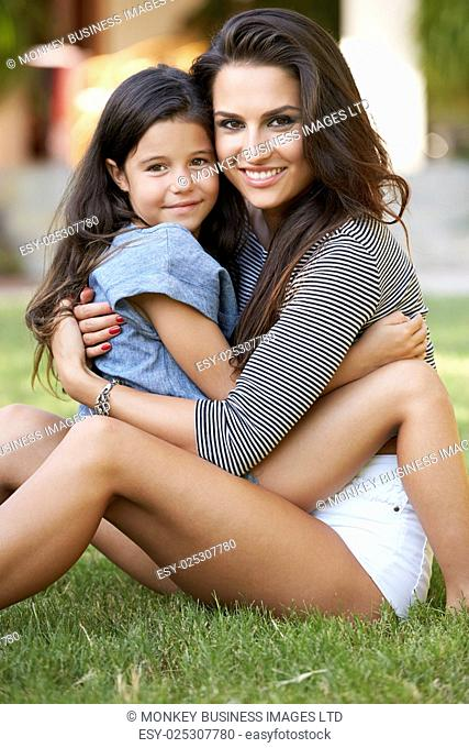 Portrait Of Loving Mother And Daughter In Garden