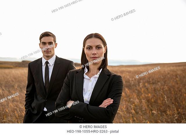 Portrait of confident business colleagues on field