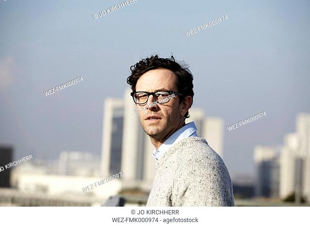 Portrait of serious looking man wearing glasses