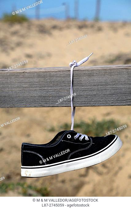 Shoe hanging in Mimizan Beach, Aquitaine, Landes, France