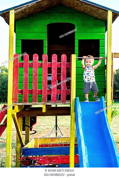 Toddler in playhouse