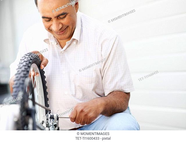 Man repairing bicycle
