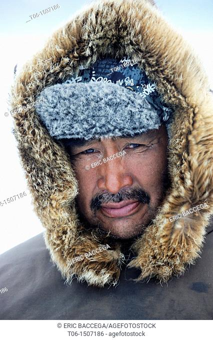 Portrait of Inuit hunter with a fur hat, Floe Edge, Arctic bay, Baffin Island, Nunavut, Canada