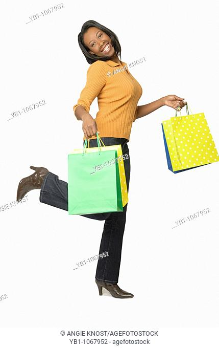 Attractive woman, African ethnicity, with colorful shopping bags