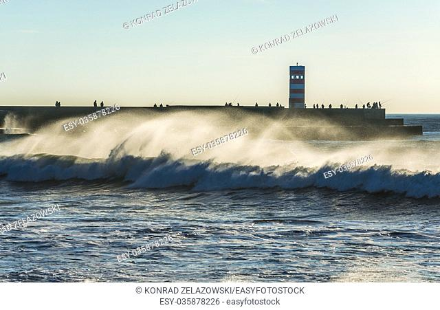 Breakwater with small lighthouse (Farolins da Barra do Douro) in Foz do Douro district of Porto city, second largest city in Portugal