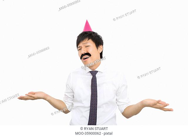 Mid adult businessman shrugging his shoulders over white background