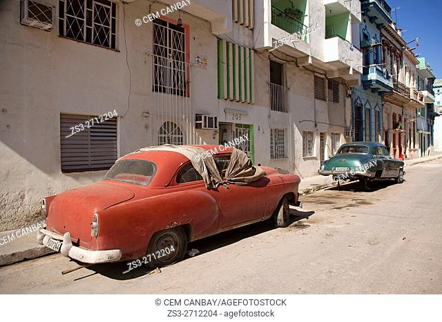 Old abandoned American cars at the street in Vedado district, Havana, La Habana, Cuba, West Indies, Central America