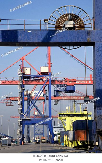 Loading cargo containers in ship, Port of Bilbao, Santurtzi. Biscay, Euskadi, Spain