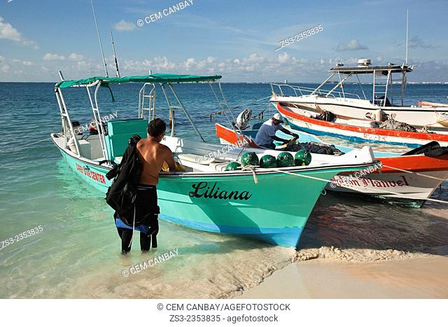 Fishermen and fishing boats on the beach, Isla Mujeres with the fishing boats at the background, Cancun, Quintana Roo, Yucatan Province, Mexico, North America