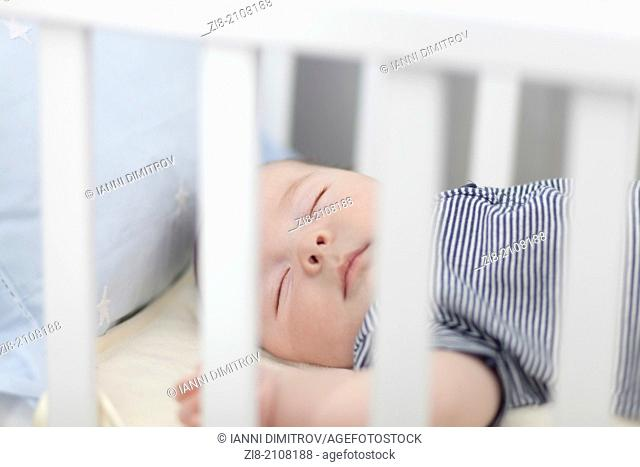 Sleeping baby in cot