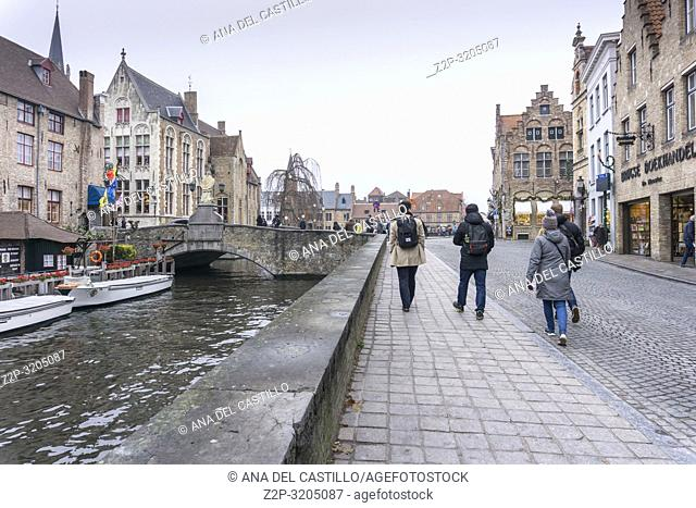Bruges, Belgium on November 25, 2018: Medieval architecture and channels in Bruges the largest city of the province of West Flanders in the Flemish Region of...