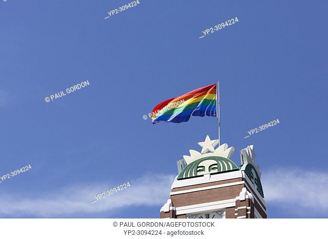 Seattle, Washington: Starbucks marks LGBTQ Pride month with the raising of the pride flag at their landmark headquarters building in Sodo