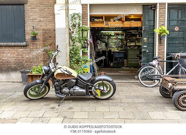 Rotterdam, Netherlands. Motorbike's workshop underneith the Highline of Hofplein Line former rairoad track